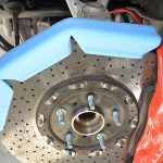 Once the bleeding is done, put the brake rotor protectors in place